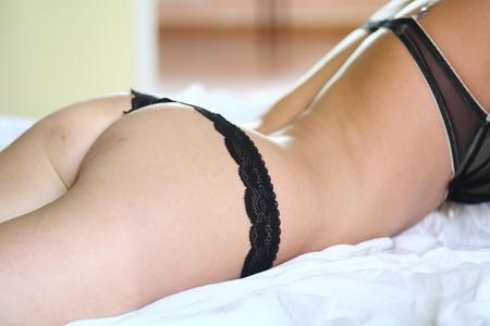 white panties: european fashion model posing in bed wearing black underwear