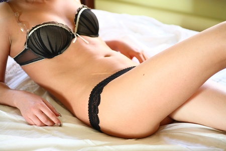 european fashion model posing in bed wearing black underwear Stock Photo - 11278131