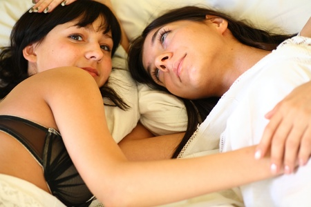Teenage Girls Lying On the Bed together photo