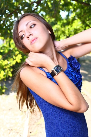 Portrait of a sexy young female in a park in blue dress Stock Photo - 11338940