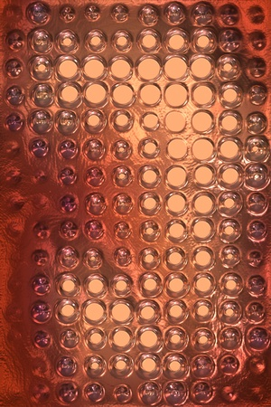 copper metal background cowered with dots Reklamní fotografie