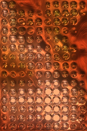 copper metal background cowered with dots photo
