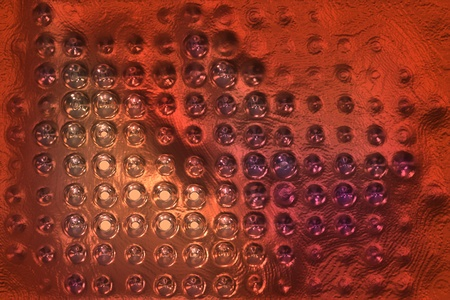 spot lit: copper metal background cowered with dots Stock Photo