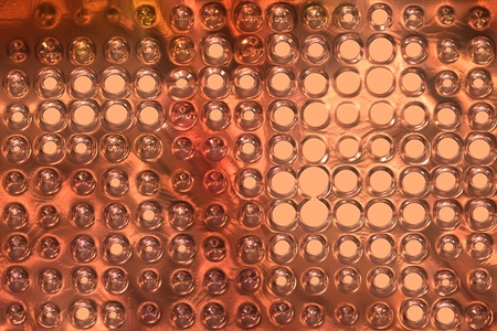cloesup: copper metal background cowered with dots Stock Photo