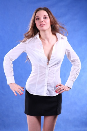 Intelligent looking female. This picture is taken in a studio on blue photo