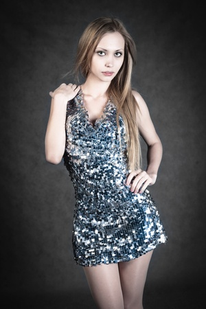Sexy blonde in gray dress Stock Photo - 12666198