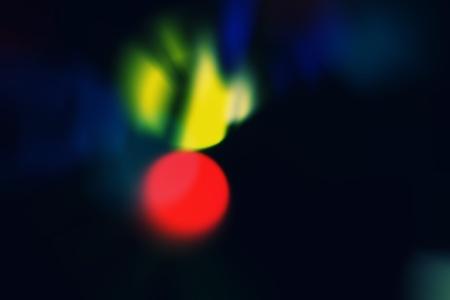 Decorative christmas background - defocused reflection of lights. photo