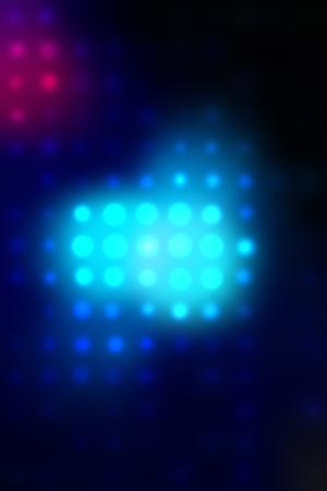 illustration of blurred neon disco light dots pattern on dark background illustration