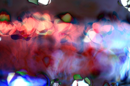 Decorative christmas background - defocused reflection of lights. photo