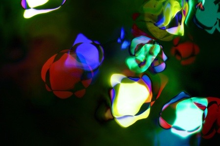 Decorative christmas background - defocused reflection of lights  photo