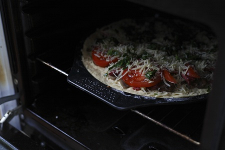 photograph of cooking pizza in the oven or stove photo