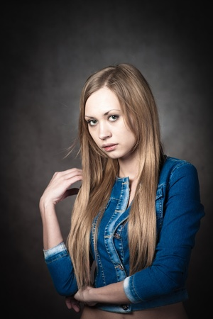 young blonde wearing jeans jacket head and shoulders Stock Photo - 13116493