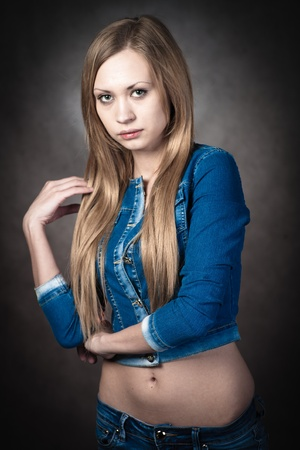 young blonde wearing jeans shorts and jacket Stock Photo - 13132262