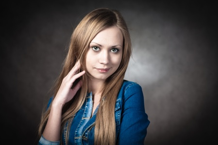 young blonde wearing jeans jacket torso shot Stock Photo - 13132100