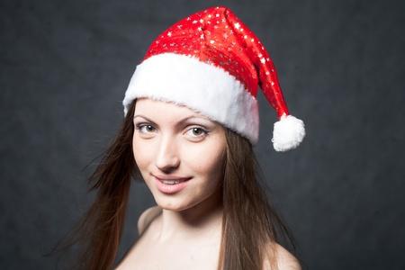 mrs santa: Mrs. Santa dreaming about Chrismas presents isolated on black background