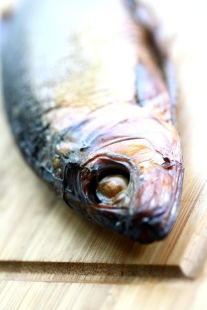 smoked fish on desk on  white background photo