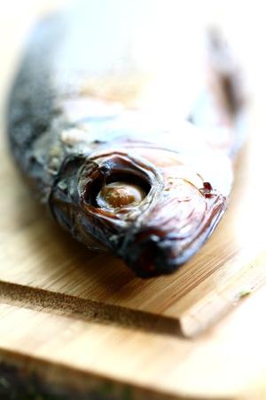 smoked fish on desk on  white background Stock Photo - 13158141
