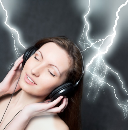 woman with headphones listening to music closed eyes photo
