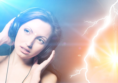 Sexy woman with headphones listening to music photo