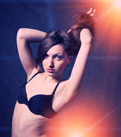 beautiful woman with long hair  girl dancing in discolight photo