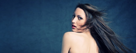 Fashion photo of beautiful seminude woman with magnificent hair photo