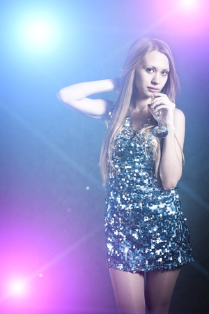 Sexy blonde in party dress dancing in discolight Stock Photo - 13260839