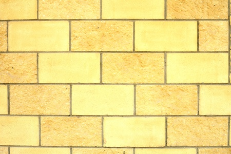 Old dilapidated brick wall of yellow brick Stock Photo - 13301346
