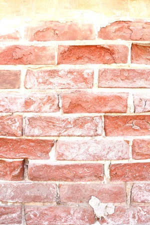 dilapidated: Old dilapidated brick wall of red brick