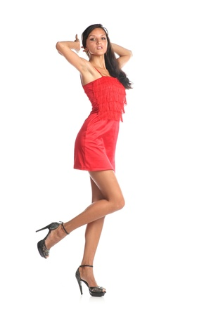 Portrait of a beautiful young woman in red dress. Isolated white background. Stock Photo - 13392794
