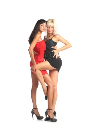 Two beautiful  glamor girlfriends standing together over white background photo