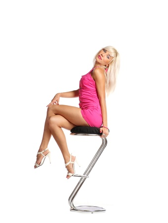 Full length of pretty young girl sitting on chair and daydreaming - copyspace photo