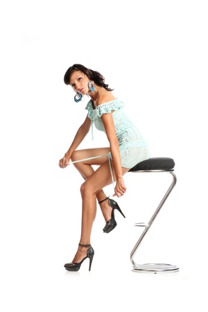 Full length of pretty young girl sitting on chair and daydreaming - copyspace