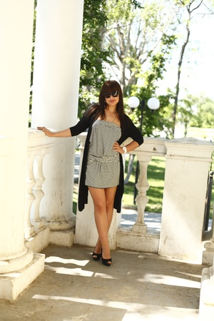 Beautiful brunette girl near greece-style ancient building in summer Stock Photo - 13393303