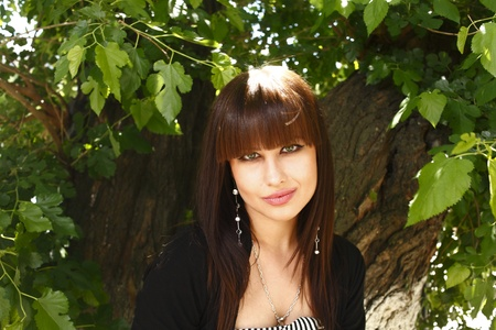 Beautiful brunette girl outdoors in summer photo