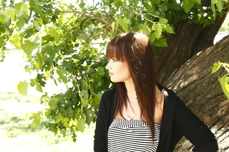 Beautiful brunette girl outdoors in summer photo