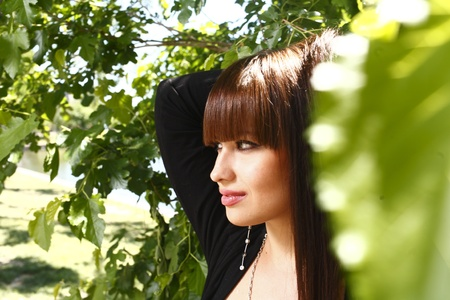 Beautiful brunette girl outdoors in summer Stock Photo - 13393332