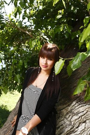 Beautiful brunette girl outdoors in summer Stock Photo - 13393486