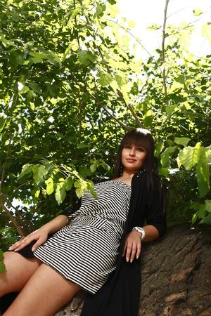 Beautiful brunette girl outdoors in summer Stock Photo - 13393523