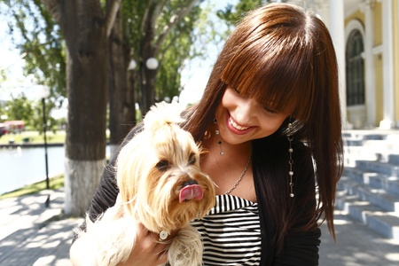Beautiful brunette girl outdoors in summer with dog Stock Photo - 13393441