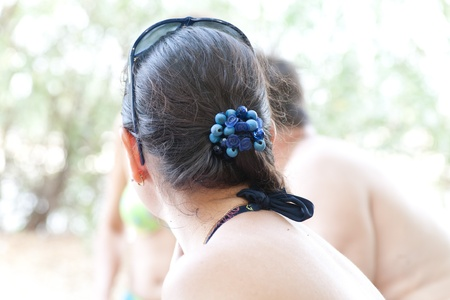 scrunchy: Woman looking away with blue scrunchy on the hairs, summer fores