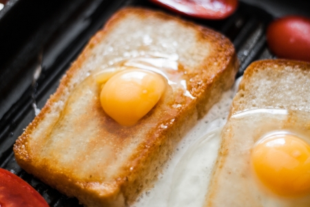 Frying pan with eggs. Breakfast for two. photo