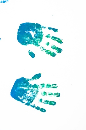 Left and right hand blue paint on white photo