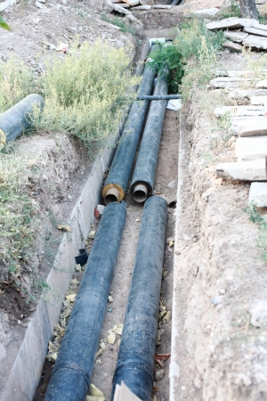 a gas pipes in the trench under construction photo