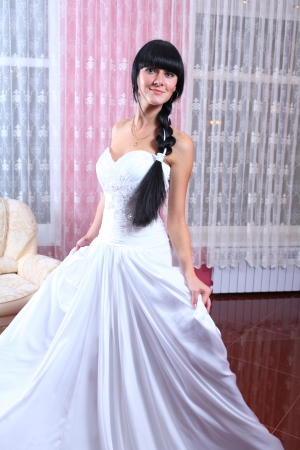 Beauty young bride dressed in elegance white wedding dress photo