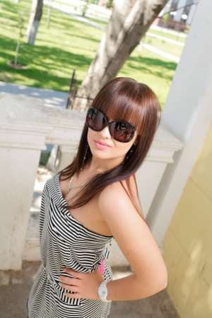 Cute woman wearing sunglasses photo