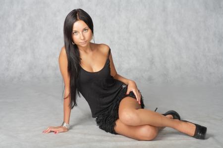 brunette sitting  down the floor Stock Photo - 17348691