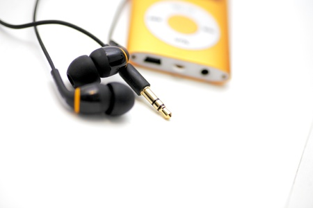 cd player: MP3 player and earphones isolated on white background low angle  Stock Photo