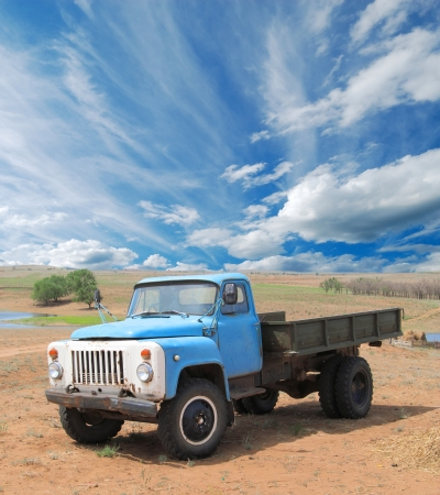 australia farm: Old blue farm truck fading in time in desert