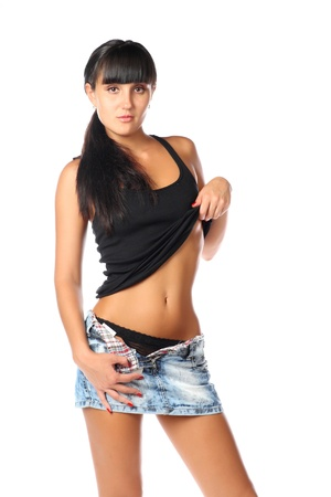 Young brunette posing in short skirt  Isolated over white background photo