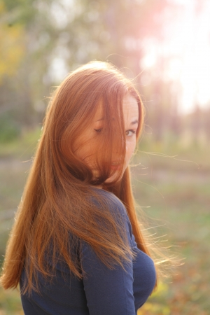 portrait of cute red haired young woman, outdoor Stock Photo - 15690184